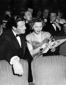 Barbara Stanwyck and her movie star husband, Robert Taylor, at the 1949 Academy Awards. Photo courtesy of the Los Angeles Public Library.
